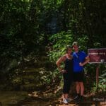 Couple with sign for St Herman's cave in Belize
